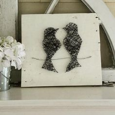 12 in x 12 in Cream background, Black embroidery floss nails and wire. Customizable.