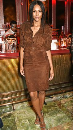 Ciara in a brown suede shirtdress and silver heels