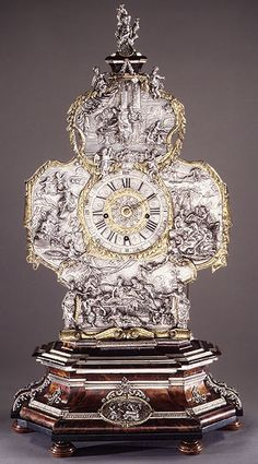 Mantel clock, movement by Franz Xaver Gegenreiner, Repoussé silver by Johann Andreas Thelot. Case: tortoiseshell veneer and silver, partly gilt; Dial: champlevé silver with black numerals; Movement: brass and steel; c. 1710
