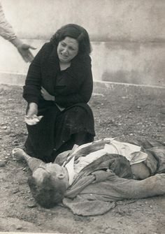 """Agustí Centelles - A woman cries over body of her husband in the cemetery of Lleida. Nov 3, 1937. In 1988, journalist Joseph Pernau, discovered the image during the making of a report, """"Children of War,"""" and became """"livid""""… those in the picture were his parents. S)"""