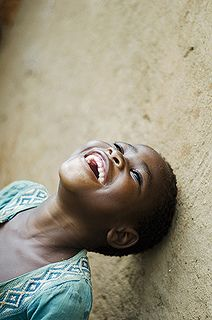 Africa | Portrait of smiling girl looking up in classroom.  Malawi, Lilongwe, Kauma Community Based Childcare Centre (CBCC) | © Anthony Asael