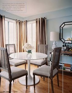 beautiful but affordable dinning room via Lonny: Restoration chairs, IKEA table, Target console and West Elm lamp. love the finished product!