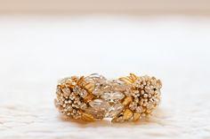 Bracelet by Miriam Haskell -- bride RENTED thru RentTheRunway.com. (It's the Secret Garden Cuff.)    Photography by erinheartscourt.com,