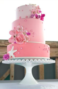 Pink ombre layered wedding cake with flowers