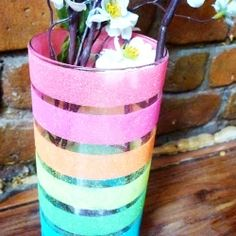 DIY Vase: A simple step-by-step tutorial on how to make this adorable vase! Think I'd prefer sand instead of glitter!