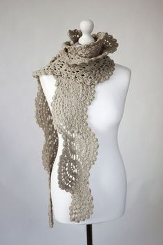 The laces scarf is crocheted in a mix wool. Color- camel ( cofee with milk ) The lent-about 92 inches The scarf I will send in a beautiful eco paper box. I am sorry , but , I do not sell patern of this scarf ! Also the item can be shipped by express shipping (DHL). Than Your
