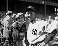 Mrs. Eleanor Gehrig stands by her husband's side before the Yankees first baseman plays a game against Washington in 1937.