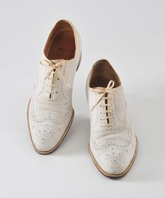 1920's Men's White Bucks Longwing Wingtip Oxfords Wedding Shoes will also go with his outfit.