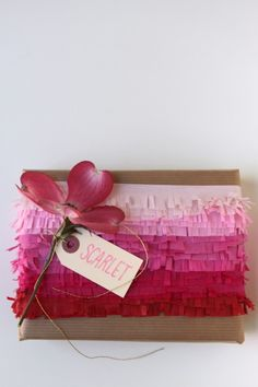 pink ombre tissue paper fringe wrapped present