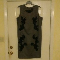 Gray Sheath Dress Two different shades of gray meet to form this absolutely adorable sheath dress. The black appliques gives it the final touch of elegance. It has a small split in the back that is still stitched close. Catherines Dresses