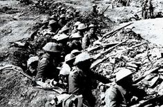 trench warfare ww1 and location - Google Search  Trench Warfare happening at The Battle of Aisne showing soldiers pointing their rifles into no mans zone maybe waiting for then enemy to push them.