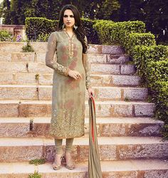 Be the sunshine of everyone's eyes dressed with this wonderful Tan Brown Georgette Unstitched Salwar Kameez. The lovely Crystals Stones & Lace work a substantial attribute of this attire.