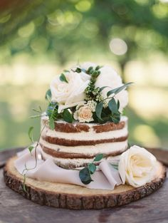 Rose topped wedding cake: Photography: Brumley & Wells - brumleyandwells.com   Read More on SMP: http://www.stylemepretty.com/2016/10/03//