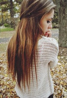Lovely, straight brunette locks with caramel highlights, pinned back.
