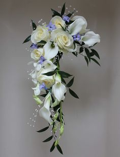 Wedding Bouquet - Bride's crescent shower bouquet featuring white orchids, calla lillies, roses and blue hyacinths. www.uniqueweddingflowers.co.uk