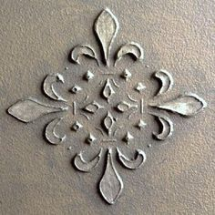 Before painting, use a stencil to create a raised pattern. Hold stencil in place, apply joint compound with a putty knife. Remove stencil. dry thoroughly before painting.    ... can be more elaborate, more high or low relief. Could be ceiling medallion, drawer or door details.