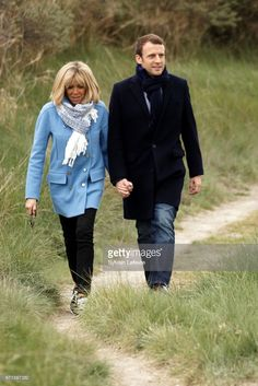 Candidate for the 2017 presidential election, Emmanuel Macron and head of the political movement En Marche! (Onwards!) and his wife Brigitte Trogneux pose for the photograph on April 22, 2017 in Le Touquet-Paris-Plage, France.  France goes to the polls for the first round of Presidential elections on April 23.  (Photo by Sylvain Lefevre/Getty Images)