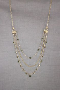 """3 different gold chains; 20.75"""" shortest, 25.25"""" longest. green apatite; by perseid on Etsy, $170.00:"""