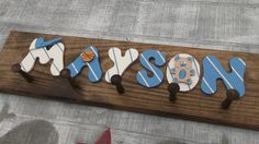 Boys Name Coat Rack. Hand crafted and Hand painted by Carolina Country Crafts. We have many colors a Hanging Medals, Sports Medals, Crafts For Kids, Diy Crafts, Clothes Hooks, Nursery Letters, Kids Zone, Maybe One Day, Country Crafts