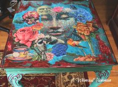 Painted an old mahogany end table and then decoupaged the top with fave images and distressed paint.