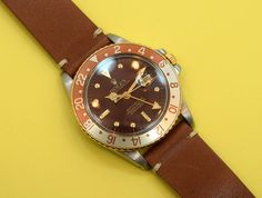 "A 1985 vintage Rolex ""Root Beer"" GMT Master. This reference 16753 two-tone, 18K…"