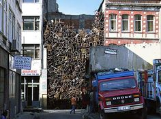 Colombian sculptor Doris Salcedo created this installation art in 2003 for the International Istanbul Biennale. Salcedo constructed the chair building in an empty lot and the edifice comprises of over 1500 chairs stacked on top of each other.