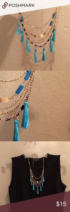 Tassel Necklace Beautiful goldtone necklace with rectangular cobalt blue beads and aqua blue tassels and sky blue cylindrical beads.  2 available. Jewelry Necklaces