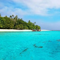 #Travel #Bucketlist #TrobriandIslands Who's up for a swim? These turquoise waters of #Kitava are incredible!  Photo via | Mark Fitz