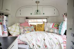 Making any place look cozy - lots of colorful pillows, made of old table cloths and duvet covers