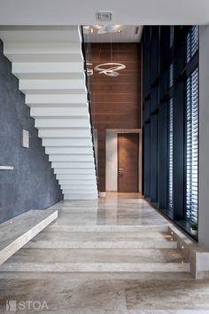 luxury interior design by Stoa Studio marble floor, white stairs, wood facade, huge luxury entrance room Wood Facade, White Stairs, Marble Floor, Luxury Interior Design, Luxury Villa, Entrance, Garage Doors, Flooring, Photo And Video