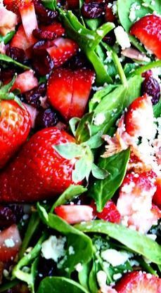 Spinach Strawberry Salad -  gorgonzola, bacon, pecans, dried cranberries topped with a wonderful balsamic dressing.    SweetLittleBluebird.com