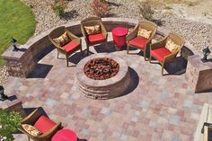 Extend your outdoor entertaning season with a fire pit and paved seating area. Shown: Basalite  AB Courtyard Pavers in Tan blend