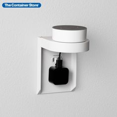 The SocketStation can turn any ordinary outlet into a convenient charging station complete with hidden cord management. It's easy to set up; simply replace an existing faceplate with the SocketStation. The shelf is slim but strong, able to hold smart speakers, phones, even electric toothbrushes and devices up to three pounds. Power cords wrap around the shelf base for tidy, out-of-sight storage. An instant way to create extra space on desktops, counters, and nightstands!