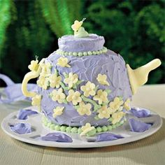 This is a fun one to make but it does require careful assembly.  As the cake turns out rather small, I recommend also baking some flowery cupcakes to go with it.