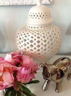 An over-sized, globally inspired element like this Moroccan pierced ginger jar from HomeGoods is a surprising addition to this coffee table. Contributing designers may receive compensation.