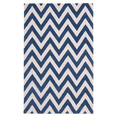Add a pop of pattern to your living room or den with this hand-tufted wool rug, showcasing a classic chevron motif in navy and ivory.  ...