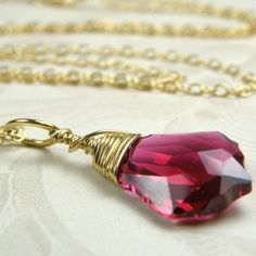Gorgeous ruby red Swarovski is hand wire wrapped with 14k gold filled wire and simply dangles on a 14k gold filled chain.    An attractive and