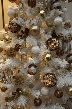 vintage inspired gold ornaments in a faux white tree