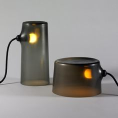 Julien Renault  Representing the stem of a tree, 'Des Souches' is a family of three cylindrical vessels in dark, natural hued glass.