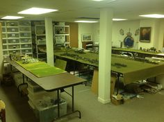 The game room of Der Alte Fritz himself. It is located in the basement and has room for one 6ft by 18ft center table and two 2.5ft by 18ft back tables, which provide depth to the game table. The workbench, painting bench and a place to relax and read are also in the same room.