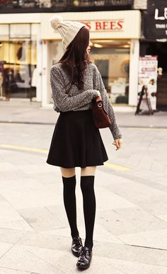 fall/winter layering idea: loving the A-line skirt and tucked in slouchy sweater. thigh highs and beanie add nice touch