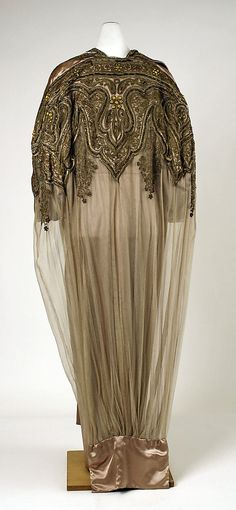 Coat, Evening.  House of Worth (French, 1858–1956).  Date: 1910. Culture: French. Medium: silk. Dimensions: Length at CB: 57 in. (144.8 cm).