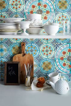 Take your kitchen back to the '70s with bright patterned wallpaper in blues, oranges and browns. Get inspired by more rustic-chic designs: