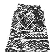 Printed Leggings Black and white geometric printed leggings. Brand new w/ tags. Size small/medium. Would fit size 4-8. Pants Leggings