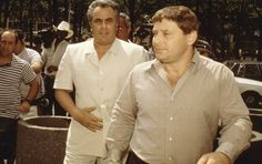"""John Gotti & Sammy """"The Bull"""" Gravano enter the Brooklyn Federal courthouse in 1986, the year Gotti was tried—and acquitted—on racketeering charges. Gotti was sentenced to life in prison after a second racketeering trial in 1992. He died of throat cancer in prison ten years later."""