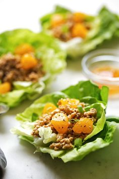 Chicken lettuce wraps stuffed with ground chicken that's seasoned with a homemade orange chicken sauce. This is the perfect low carb high protein dinner!