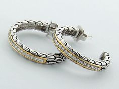 Sterling Silver (925) Hoop Earrings with cubic Zerconia and 14K gold, weights 15 gram, length is 1.2 inch.