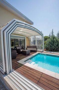 Particolare copertura telescopica: Giardino con piscina in stile  di Isobit s.r.l.