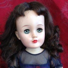 A gorgeous brunette V-22 Revlon in an original dress.  I love the brunettes!
