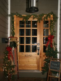 Vintage Decor:     Rate My Space user clonning created an inviting holiday entrance by using vintage finds and plenty of greenery. She strung lights through the garland and miniature Christmas trees. A vintage sled and chalkboard stand add a creative touch to the festive porch.